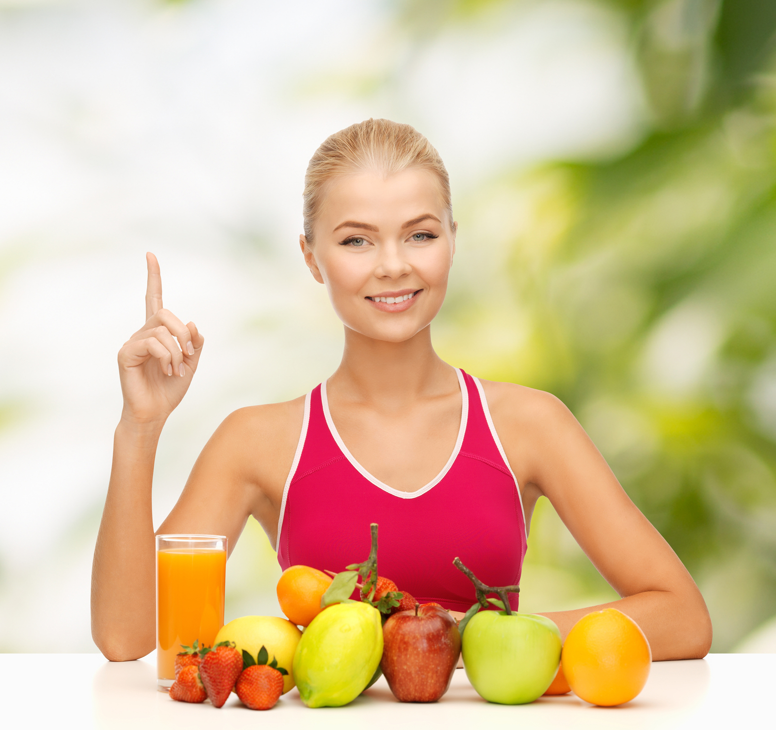 fitness, diet and food concept - young woman with organic food o